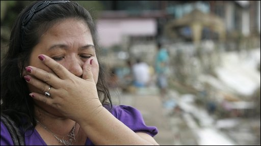 Woman stands overwhelmed after Manila floods