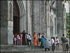 Catholics outside a church in Vietnam