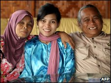 Kartika Sari Dewi Shukarnor (C) with her parents in Karai, north of Kuala Lumpur, 22 August