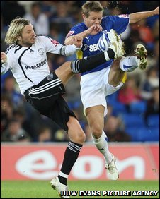 Stephen McPhail (right) challenges Derby's Robbie Savage