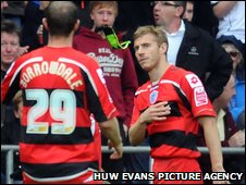 QPR's Martin Rowlands throws away his skipper's armband after his red card, a crucial turning point