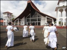 Women attend a National Prayer Service in the village of Kanana Fou in American Samoa