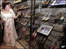 Philippine former first lady Imelda Marcos points to some of her shoes on display at the museum, 2001 picture