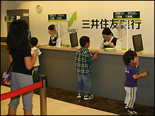 Children queue to deposit their money at Kidzania bank