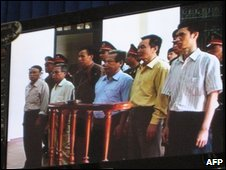 The six defendants shown on a TV monitor in a Haiphong court room - 8 October 2009