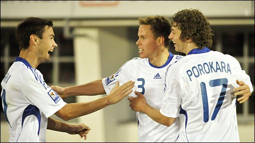 Finland players celebrate the winner against Wales