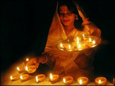 Lighting diyas during Diwali