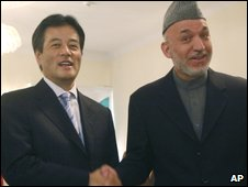 Afghan President Hamid Karzai, right, shakes hands with Japanese Foreign Minister Katsuya Okada after the inauguration of a polio immunisation campaign at the presidential palace in Kabul, Afghanistan, on Sunday