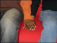 Men holding hands, file image