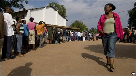 Voters queue to cast their votes at a polling station in Gaborone