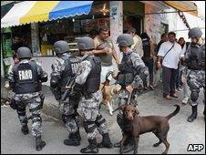 Police patrolling streetsof the Jacarezinho shantytown on 19 October