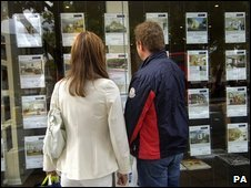 "People outside an estate agent""s window in London"