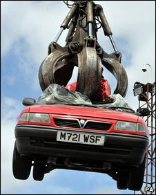 A car being scrapped in a breakers yard in Harrow, North West London.