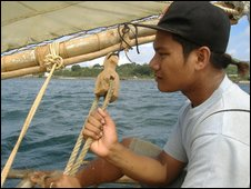 Yapese man sailing traditional canoe