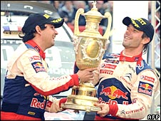 Co-driver Daniel Elena and Sebastien Loeb celebrate