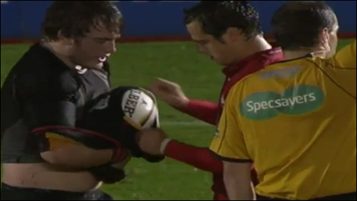 Dragons prop Hugh Gustafson tries to get away with the old 'ball up the jumper move' against the Scarlets in Scrum V's Commentator's Balls...