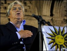 Luis Alberto Lacalle sings the national anthem at a rally after Sunday's vote