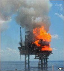Handout photo provided by PTTEP Australasia shows fire on the West Atlas drilling rig