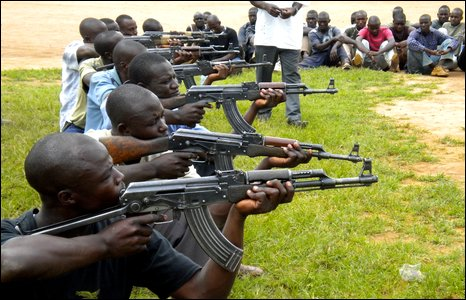 Ugandans practicing with AK47s at Watertight training ground