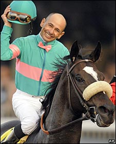 Jockey Mike Smith celebrates after guiding Zenyatta to victory