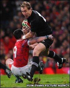 Wales scrum-half Gareth Cooper tackles Jimmy Cowan