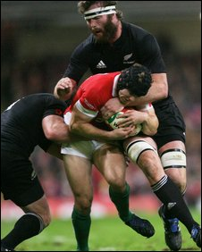 Wales' Leigh Halfpenny is tackled by Wyatt Crockett and Jason Eaton