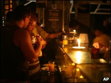 Candles light customers in a Rio de Janeiro restaurant