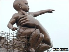 Close up of the baby figure in the African Renaissance statue