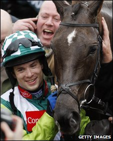 Sam Thomas celebrates his Gold Cup win with Denman