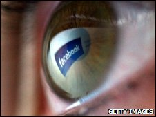 Facebook logo reflection in human eye, Getty