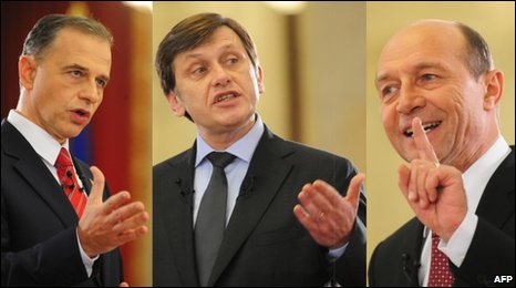 Romanian presidential candidates Mircea Geoana (L), Crin Antonescu (C) and incumbent Traian Basescu (R) at an election debate in Bucharest