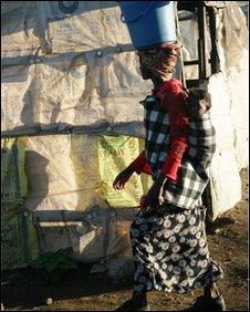 Zambian woman carrying goods