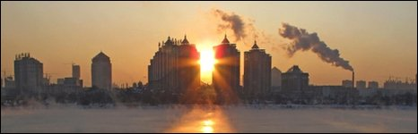 Smoke rises over the skyline of Jilin, China