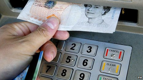£10 note being taken out of cash machine