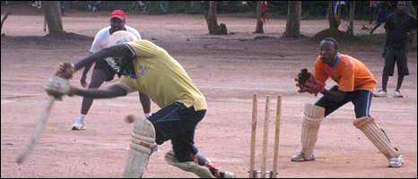 Young Rwandans enjoy a game of cricket