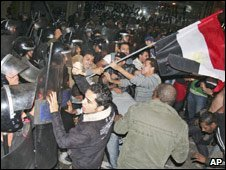 Egyptian soccer fans clash with anti-riot police during a demonstration near the Algerian embassy in Cairo (Nov 20, 2009)