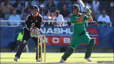 AB de Villiers punches the ball into the off side as Matt Prior looks on