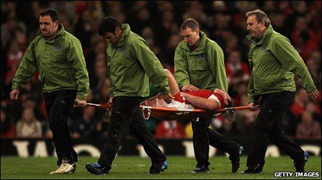 Matthew Rees is stretchered off after half an hour of Wales v Australia