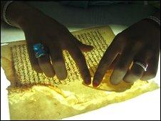 Hands holding fragile paper