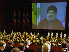 Hassan Nasrallah on video screen