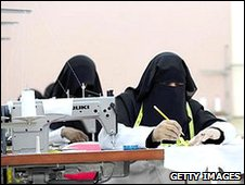 Women seamstresses in Saudi Arabia dressed in the Niqab