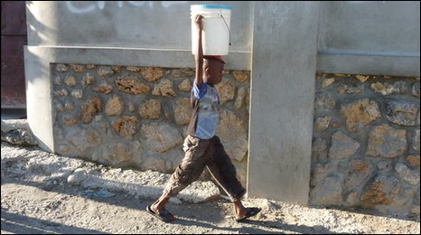 Boy carrying water in Haiti