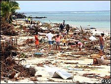 Survivors searching through the debris on Lalomanu Beach