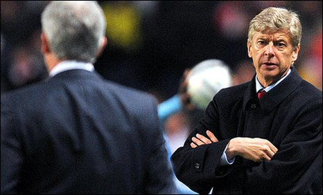 Arsene Wenger (right) and Mark Hughes exchange words on Wednesday