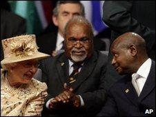 Queen Elizabeth II (left) and Uganda's President Yoweri Museveni (right)