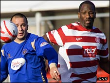 Marvin Andrews (right) in action against St Johnstone