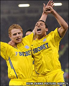 Chris Burke celebrates his goal with Michael Chopra