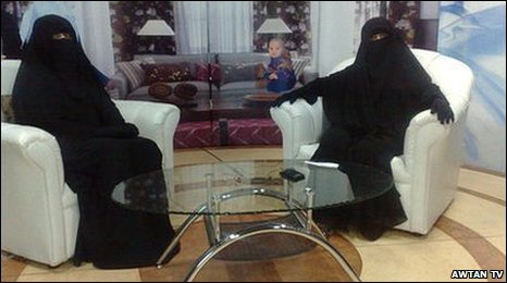 Two women TV presenters in Saudi Arabia dressed in the Niqab