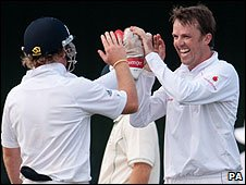 Ian Bell congratulates Graeme Swann on a wicket