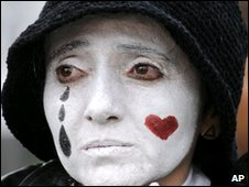 Woman with face painted with a tear during a demonstration for press freedom in Quito on 9 December
